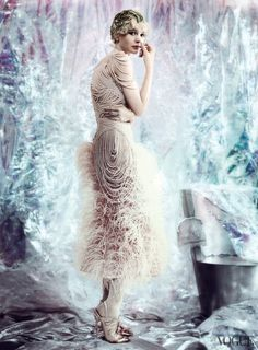 Carey Mulligan in a Alexander McQueen ostrich feather dress with chiffon-covered pearls