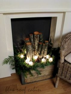 Okay, for homes that doesn't have chimneys and fireplace, here are DIY Christmas lighted decorations. Old crate filled with logs, greens, pine cones, and string lights