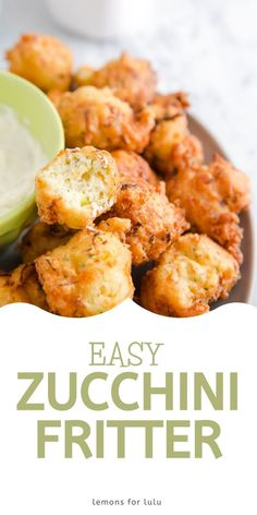 Do you have an abundance of garden zucchini? Zucchini fritters make a great appetizer or snack! These crips nuggets are best served warm with a dipping sauce on the side. Fritters are easy and fun to eat and make a great way to use up summer's best vegetables! Pumpkin Fritters, Zucchini Fritters, What Is A Zucchini, Savoury Dishes, Food Dishes, Yummy Snacks, Delicious Recipes, Great Appetizers, Recipe Collection