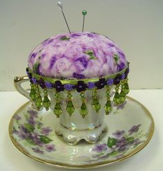 Cute teacup pincushion - love the beaded trim! :)Idea - make own beaded trim by sewing beads onto ribbon or trim.