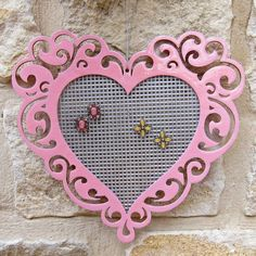 Tutorial: DIY Jewelry Organizer with Plastic Canvas  Could do this with any frame.