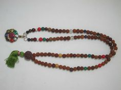Amazon.com: Navratna Rudraksha Mala 108+1 Beads Empowers Good Effects of All Planets: Tarini Jewels: Jewelry