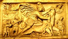 bas relief from the mithraium under the circus maximus. Mithras is portrayed in this relief wearing a tunic, trousers, a cloak and Phrygian cap and is shown in the act of killing a bull. A snake licks the bull's wound; the bull's tail is transformed into ears of corn; below, a small dog rises up on its hind legs and places its front paws on the chest of the victim, while a scorpion bites the animal's testicles.