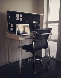 Jackie Saik's sapce saving and elegantly organized IKEA desk on wheels is made with Ikea elements and keeps your place looking clean when you're not working and it's folded.