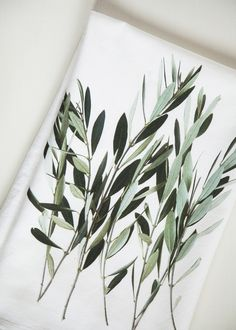 A composition of Olive Branches are printed in this beautiful kitchen towel. Color, shape and detail make this farm-style towel a unique gift. Pair it up with our French Breakfast towel to make a uniq