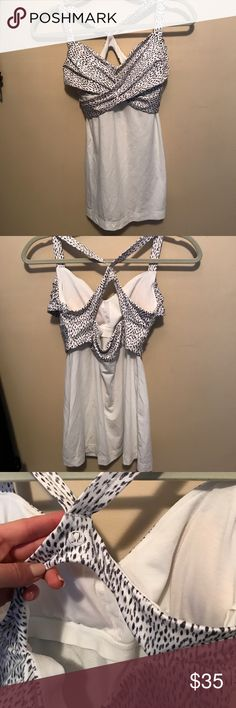 Lululemon Wrap It Up tank, size 6 White / white & black print wrap it up tank, size 6. Worn once. No stains or marks, in perfect condition! lululemon athletica Tops Tank Tops
