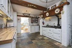 Aga kitchen slate floor and beams