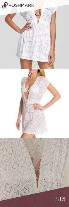 White J Valdi Diamond O-Ring Cover Up Bright white diamond holes sheer beach cover-up. Deep V. Worn once! Style unavailable online! Cover up in ultra-feminine style with this Circles O-Ring Cover Up. The diamond mesh design adds a rich style to a comfortable and cool cover-up choice.   First photo for styling J Valdi Swim Coverups