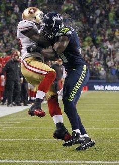 San Francisco Vernon Davis, left, is hit by Seattle Seahawks' Kam… Football Hits, Nfl Football Games, Football Season, Football Players, Seahawks Vs 49ers, Seahawks Football, Seattle Seahawks, 49ers Pictures, Kam Chancellor