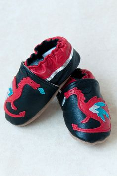 Dragon Fire Baby Shoes all-leather (red, black, silver, metallics). $32.00, via Etsy.
