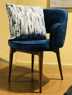 Featuring a Blue Velvet cover, Heavy-duty frame, European walnut finish, Attractive piping and Mid-century modern styling <3 <3 ---Maya---