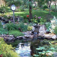 pond with waterfall ... my next back yard . !!