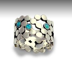 Sterling silver dotted wedding ring inlaid blue opals gemstones - Yet to discover. $98.00, via Etsy.