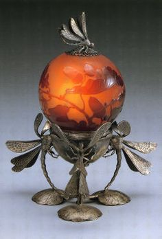 Gorgeous glass supported on dragonfly base.