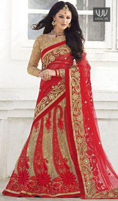 Stylish Red Color Net Designer Lehenga Saree Be the sunshine of everybody's eyes dressed in such a gorgeous red net lehenga saree. Beautified with embroidered, patch border, resham and zari work all synchronized well with the pattern and design of the attire.