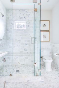 This beautiful bathroom with walk-in shower, designed by Emily Johnston Larkin, is sure to inspire your next bathroom remodel or renovation, via @sarahsarna.