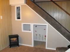 This is the indoor playhouse we built under the downstairs stairs. It is the perfect fit for thier play kitchen.