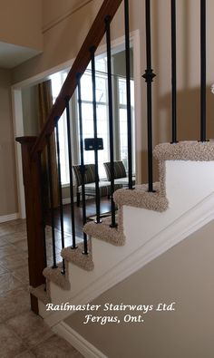 Carpet Grade Stairs with Wrought Iron Spindles
