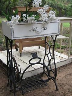Old sewing machine base & drawer repurposed as a planter