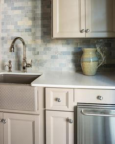 Serene coastal kitchen with blue-tone tiles.