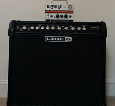 Use a combo amp as a cabinet (cheap and easy)