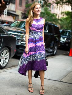 Marina Larroude, fashion director at Teen Vogue wears a printed, statement-making dress with gladiator heels