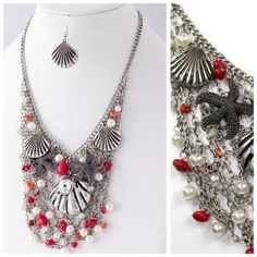 """D6 Red Silver Crystal Starfish Sea Shell Necklace ‼️PRICE FIRM‼️   Beach Theme Necklace  Super fun, beautiful necklace.  This is a handmade substantial necklace made with the highest quality charms.  Sure to dress up even the most basic outfit.  Silver color with beach theme charms.  Red accent beads, faux pearls.  Lobster clasp.   Approximately 21"""" long,  with a 3"""" adjustable extender chain.  Cluster is approximately 7"""" wide by 5"""" long. Matching shell earrings included.  Earrings are…"""