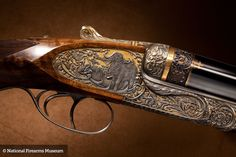 Fitted inside an oak and leather casing, this Philippe Grifnee engraved  .577 Holland & Holland Nitro Express double rifle has its gold background receiver deeply carved with African game species including Cape Buffalo and Rhinoceros.