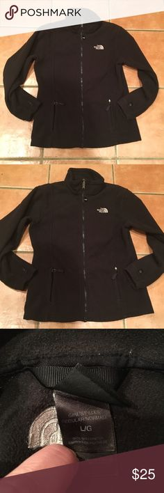 Girls The North Face fleece jacket Black fleece. Two front pockets. In good used condition. Zippers in good condition. Logo on Front and back. The North Face Jackets & Coats