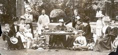 Stern: Formally-dressed Royals gather round Queen Victoria, centre, in a suitably dour tea party as Osborne House. By this time she was wearing her customary black