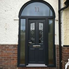Fantastic arch combination door in grey from www.xtremedoor.co.uk composite doors