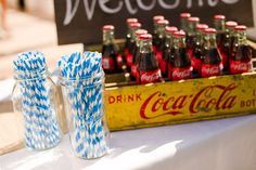 striped straws -- love this idea for straws & vintage coca cola boxes...only my coca cola boxes don't have the dividers for each bottle of coke.  line with plastic and toss in ice, perhaps?