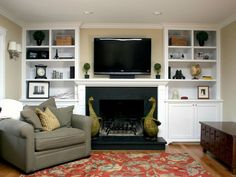 Simple white built in bookshelves with lower cabinets for both sides of fireplace up to ceiling