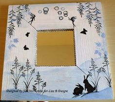 Mirror decorated by Jan M. Lavinia Stamps, Distress inks.