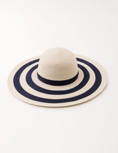 The perfect companion to seaside walks and balmy drinks on the terrace: this floppy hat comes in an endlessly-outfitable striped design. Team it with your biggest sunglasses and your swishiest dress when the sun decides to shine.