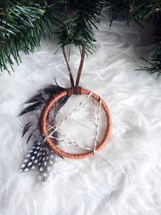 Mini Dream Catcher Christmas Ornament - Modern Rustic Holiday Decor - Bohemian Hostess Gift - Modern Boho Dreamcatcher Ornament -Gift Topper by BastandBruin on Etsy https://www.etsy.com/listing/469801760/mini-dream-catcher-christmas-ornament