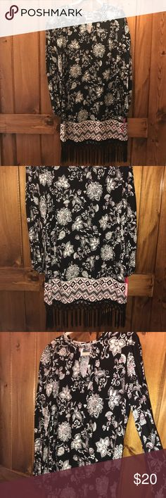 NWT Floral Fringe Dress Floral patterned dress with fringe on the bottom. Brand new ! Still has tags. Small peep hole opening with clasp at the top. Xhilaration Dresses Midi