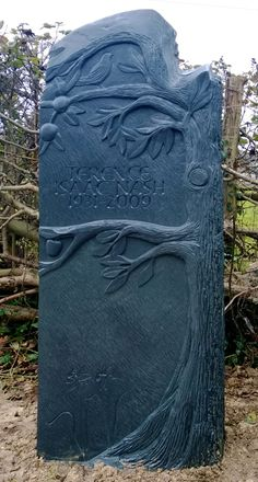 Welsh slate memorial on vertical tree/with bird and fruit daffodils at bottom remind me of mom's spring garden