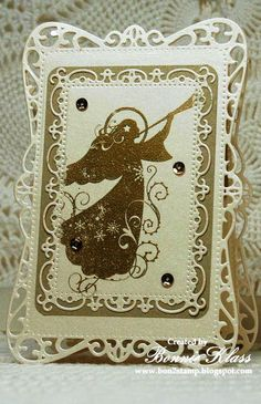 handmade card from Stamping with Klass ... elegant ... metallic gold and shimmery ivory ... intricate die cut layers ... piercing ... gold stamped angel ... three sequinces ... awesome card!!