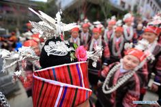 People of Miao ethnic group take part in a dancing contest in  Guizhou Province, Feb. 11, 2016. Local people in festival array participated in the contest to celebrate the Spring Festival.   http://www.chinatraveltourismnews.com/2016/02/miao-ethnic-people-participate-in.html