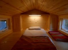 22 long Ynez tiny house by Oregon Cottage Company - loft bed with headboard and side cabinets