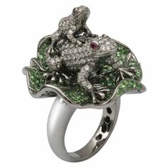 White gold and diamonds frogs resting on a lily pad ring in gold and tsavorite by MVee