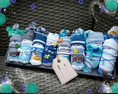 Items similar to Diaper Babies Gift Basket - Adorable basket of socks, wash cloths and diapers for expecting moms, baby shower gifts or party favors! on Etsy Unique Baby Girl Gifts, Diy Baby Gifts, Unique Baby Shower Gifts, Baby Gift Sets, Burp Cloth Diapers, Baby Burp Cloths, Couches, Expecting Mom Gifts, Baby Washcloth