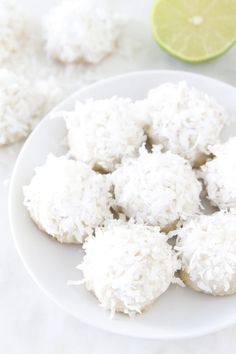 Lime Coconut Snowball Cookie Recipe on twopeasandtheirpod.com These are our FAVORITE cookies. A fun cookie for the holidays or anytime!
