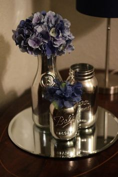"Mason jar spray painted with Krylon's ""Looking Glass"" spray. LOVEEEE! Great way to reuse all my mason jars!"