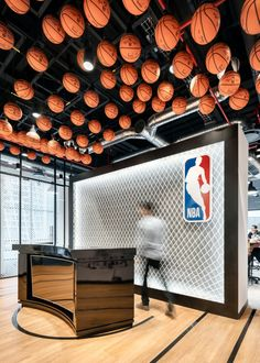 KMD Architects have completed the offices for the National Basketball Association (NBA) located in Mexico City, Mexico. The new offices of the National Commercial Interior Design, Shop Interior Design, Commercial Interiors, Retail Design, Corporate Interiors, Office Interiors, Sportbar Design, Indoor Basketball Court, Basketball Store