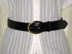 'COACH Vintage Shiny Black Leather Belt Small' is going up for auction on Tophatter.