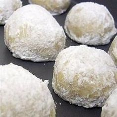 Plump, tender little cream cheese cookies, rolled in confectioners' sugar and optional walnuts, look like little snowballs. They have a hint of almond flavor.