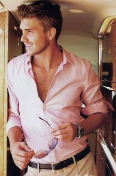 There's something ridiculously attractive about a confident man who can pull off wearing a pink shirt.