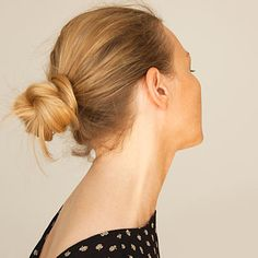 A low, tight bun is a cool and cute way to style your hair this summer. Find out more easy summery hairstyles. | Health.com